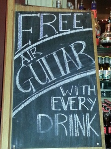 Free air guitar with every drink sign. Pub in Dublin, Ireland