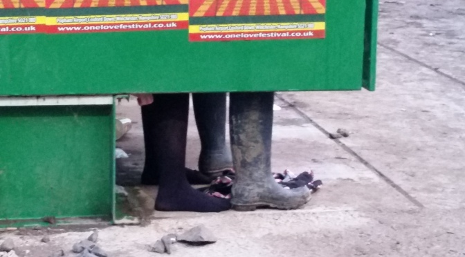 Feet in the toilets at the Glastonbury festival 2015