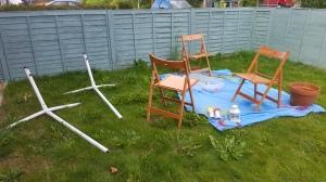 Chairs, hammock stand, lantern and pot