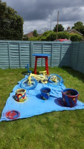 Colourful table, bike and pots