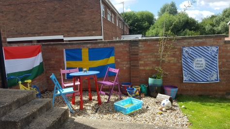 Colourful garden with flags