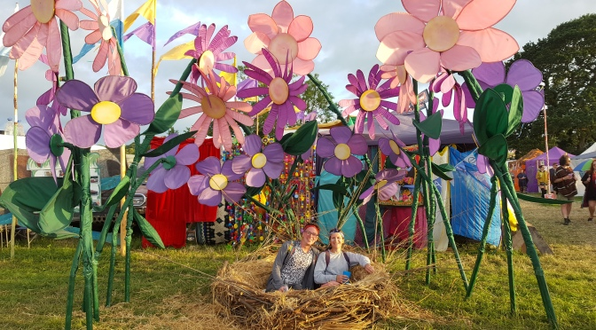 Bright giant flowers and a birds nest at Glastonbury Festival 2017